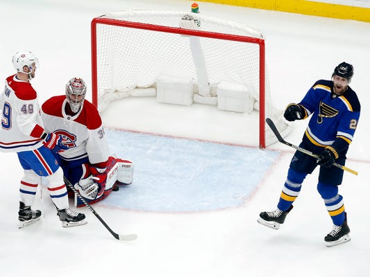 St. Louis Blues' Patrik Berglund, right, of Sweden, celebrates after scoring past Montreal Canadiens' Carey Price (31) and Logan Shaw (49) during the third period of an NHL hockey game Tuesday, Jan. 30, 2018, in St. Louis. The Blues won 3-1. (AP Photo/Jeff Roberson)