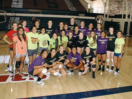 Bill Armendariz - Headlight Photo   A treat for the Deming High Lady Wildcat volleyball team was receiving a visit from the Western New Mexico University Mustang women and watching them practice on the DHS Gymnasium court. They posed for a group shot with the Rocky Mountain Athletic Conference players.