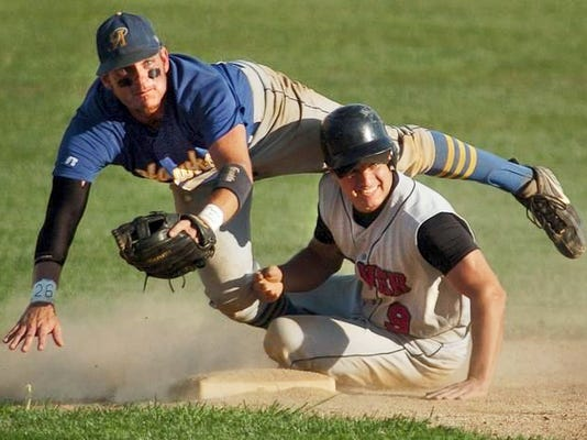 Dover's Kory Raber breaks up a double-play attempt in Central League action. The Raber brothers are known for their hard-nosed style of play.