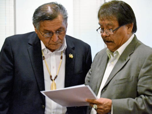 Navajo Nation President Ben Shelly, left, talks to Arbin Mitchell, his chief of staff, during a Navajo Nation Supreme Court recess on Saturday in Tsé Bonito.