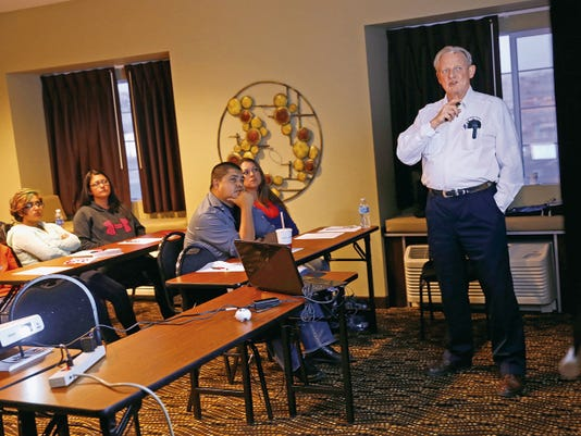 Brian Swanhart, an instructor with Straight Scoop for Vets and Friends, leads a suicide prevention training on Thursday in a conference room at the Microtel Inn and Suites in Aztec. The Aztec Municipal School District hosted the event as part of its effort to offer more training and prevention information for parents, educators and students.