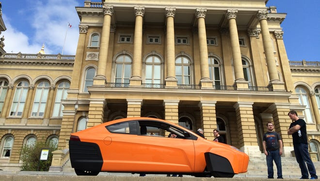 An Elio vehicle by Elio Motors outside of the Iowa State Capitol in Des Moines on Tuesday, April 19, 2016.