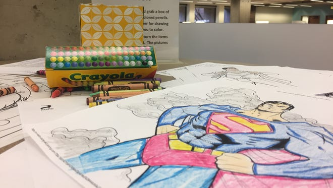 """An """"art relaxation station"""" is set up at Purdue's Hicks Undergraduate Library during prep and finals week to help students de-stress."""