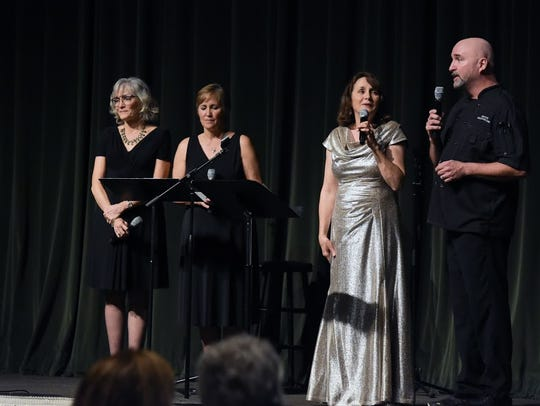 Soprano vocalist MaryAnn Lee Rutter, center, with Executive