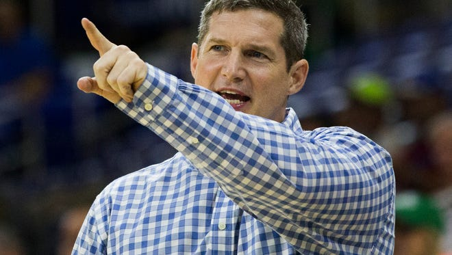 Karl Smesko, head coach for Florida Gulf Coast University,  yells out to his team during the women's basketball home opener at Alico Arena in Fort Myers on Tuesday, November 15, 2016. Florida Gulf Coast University beat Florida International University 89 to 42.