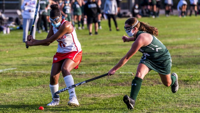 Kennedy Franklin winds up for a long crossing pass, as Dartmouth's Katherine Quinn looks to get a stick on it.