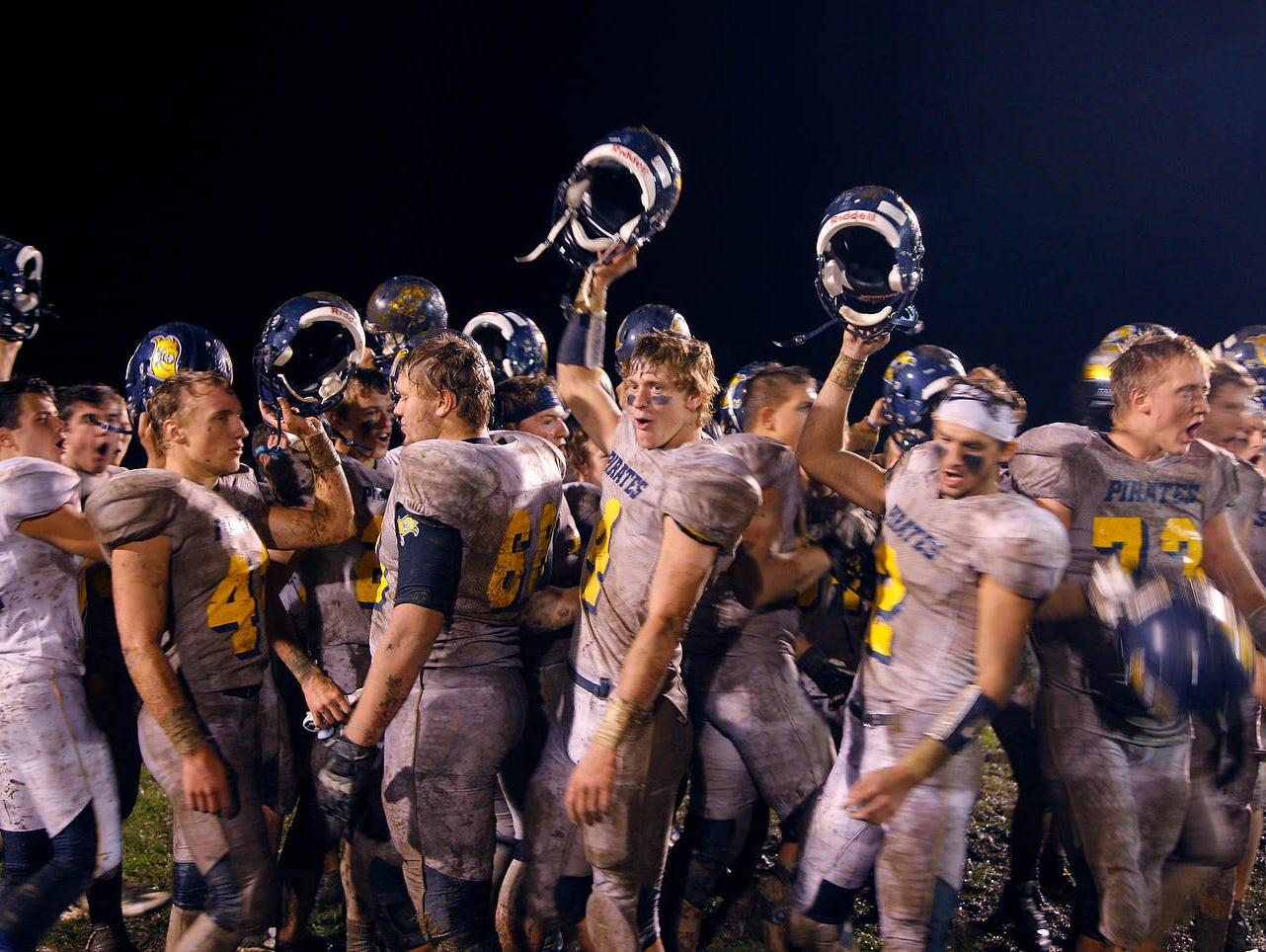 Pewamo-Westphalia players celebrate following a 40-7 win over Laingsburg Friday, Sept. 30, 2016, in Laingsburg, Mich.