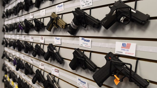 Handguns are displayed at the Ultimate Defense Firing Range and Training Center in St Peters, Missouri.