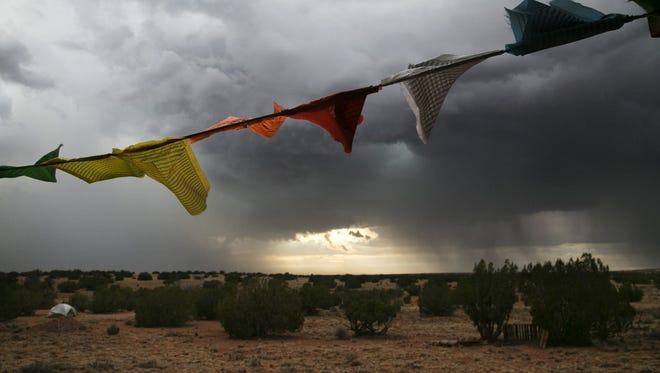 Flags flap in the wind during a monsoon storm in a remote part of rural Navajo County outside Holbrook on July 14, 2018.