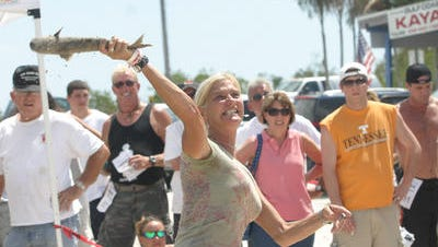 Contestants will throw fish for distance during the 25th annual Mullet Toss Champsionship in Matlacha.