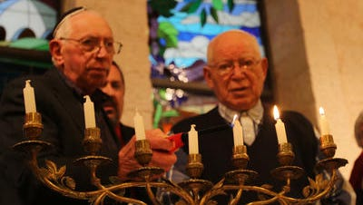 Henry Shery, of Manchester, (LEFT) and Hy Josovitz, of Toms River, light a candle to remember the 6 million Jews who perished in World War II during a Holocaust Memorial Service, at Congregation B'nai Israel, Wednesday, May 4, 2016. They are both Holocaust survivers.