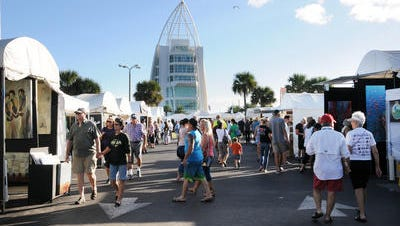 People wander among the booths on the first day of the Space Coast Art Festival Saturday at Port Canaveral.   People wander through the various booths on the first day of the Space Coast Art Festival Saturday at Port Canaveral.