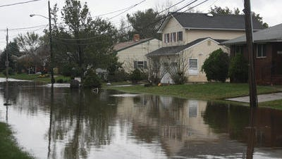 Floodwaters from Hurricane Sandy ravaged homes on Weber Avenue in Sayreville. Many of those homes have been purchased by the Blue Acres Buyout program.
