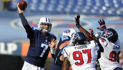 Titans quarterback Zach Mettenberger (7) throws a pass against the Texans defense.