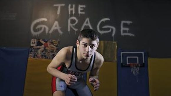 Yianni Diakomihalis, shown here at the wrestling room at his family's home, was the 2013 Democrat and Chronicle All-Greater Rochester Division I Wrestler of the Year as an eighth-grader.
