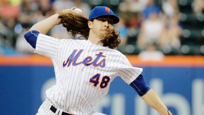 Mets starter Jacob deGrom delivers a pitch against the Angels Friday night at Citi Field. DeGrom allowed just four hits in seven scoreless innings.