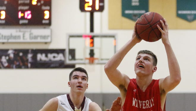 Scott Woodring of Waverly puts up a shot in front of Aaron Austenfeld of Whitney Point on Friday in the IAC Large School final at Tompkins Cortland Community College.