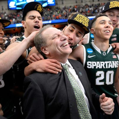 Tom Izzo and players celebrate following Sunday's 76-70