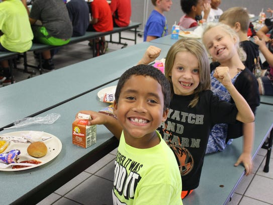 A class at Pinewood Elementary in Mims eats lunch Monday