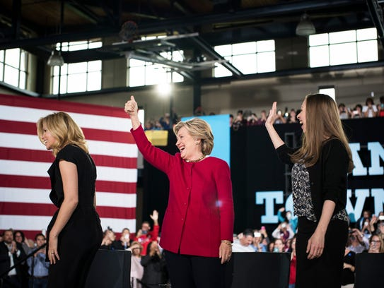 Hillary Clinton, with her daughter, Chelsea, and the