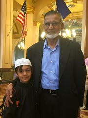 Mohamad Khan of Des Moines and his grandson, Ibrahim Benedict of Pleasant Hill, on Muslim Day at the Iowa Capitol.