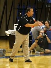 Express volleyball coach Rob Arciolla encourages his