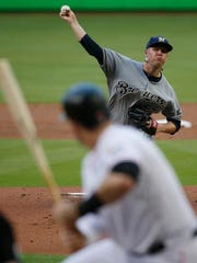 Brewers' Chase Anderson pitches to Miami Marlins' Justin