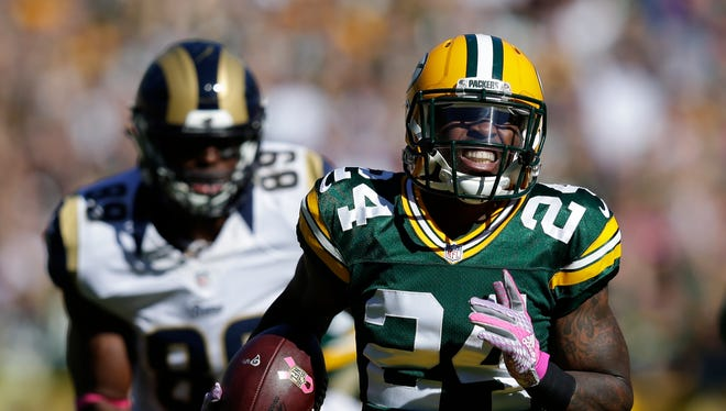 Green Bay Packers cornerback Quinten Rollins (24) returns an interception for a touchdown against St. Louis Rams at Lambeau Field.