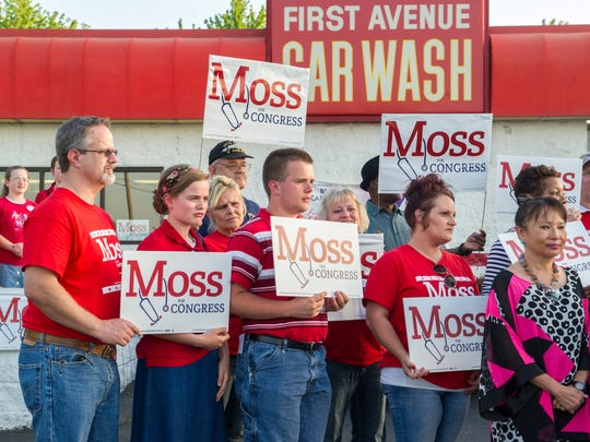 Richard Moss supporters are seen at First Avenue Car Wash where Moss held a party in expectation of winning the 8th District race.