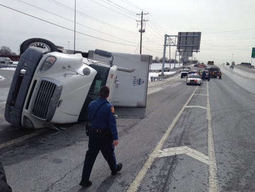An overturned tractor-trailer caused delays just after noon Tuesday at the ramp from westbound I-295 to northbound Del. 9 (New Castle Avenue) near New Castle.