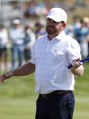 U.S. team member J.B. Holmes reacts on the first hole during the first day of the Presidents Cup at Jack Nicklaus Golf Club Korea.