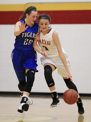 Luxemburg-Casco's Cassie Schlitz (3) dribbles up the court against Wrightstown's Danielle Nennig (20) in a girls basketball game at Luxemburg-Casco High School on Tuesday. See more photos from the game at greenbaypressgazette.com.