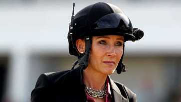 NBC commentator Donna Barton Brothers rides down the front stretch before the 88th Black-Eyed Susan Stakes at Pimlico Race Course in  2012. She will be a reporter for Saturday's Preakness.