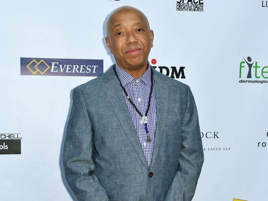 AP RUSSELL SIMMONS-HORSE CARRIAGES A FILE ENT USA CA