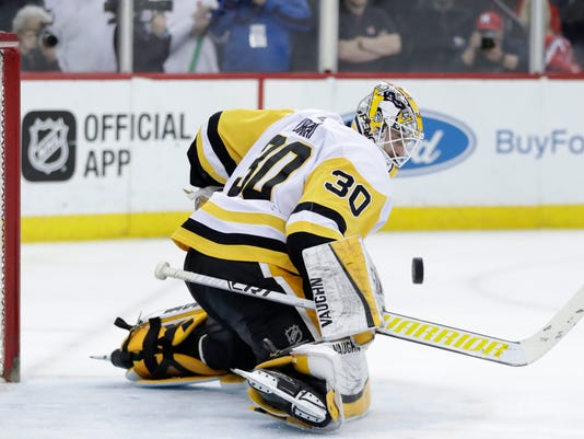 Pittsburgh Penguins goaltender Matt Murray blocks a shot from the New Jersey Devils during the second period of an NHL hockey game Thursday, March 29, 2018, in Newark, N.J. (AP Photo/Julio Cortez)