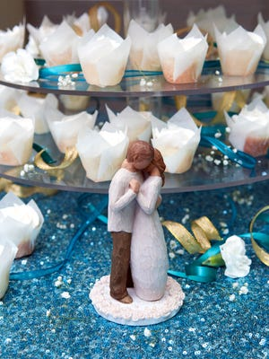 Mr. and Mrs. Garrett Arnold's wedding cake was provided by Let Them Eat Cake. The couple won a free wedding sponsored by vendors of the Las Cruces Bridal Showcase.