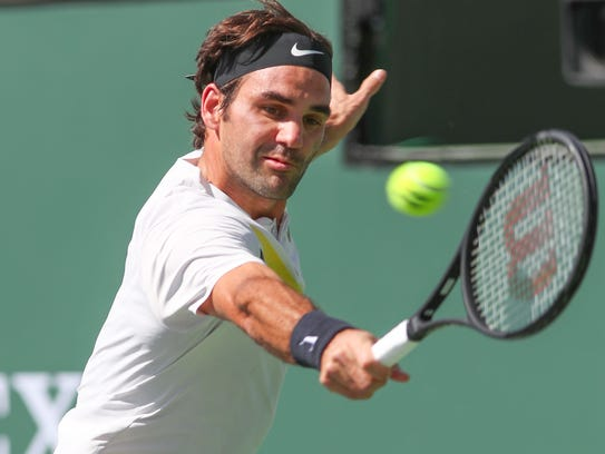 Roger Federer hits a backhand during his win over Filip