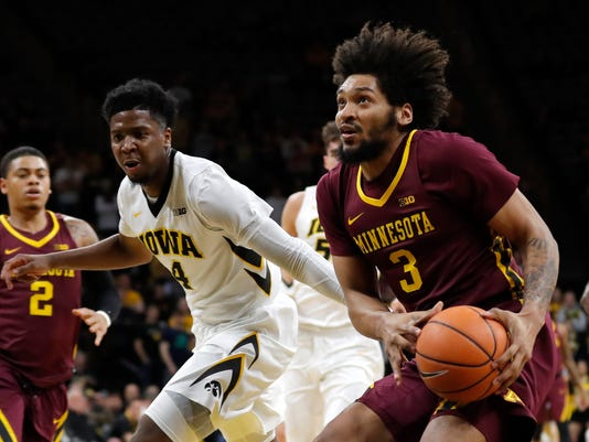 Minnesota forward Jordan Murphy (3) drives to the basket past Iowa guard Isaiah Moss, left, during the first half of an NCAA college basketball game, Tuesday, Jan. 30, 2018, in Iowa City, Iowa. (AP Photo/Charlie Neibergall)