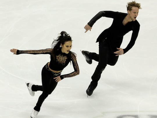 Madison Chock and Evan Bates perform during the short