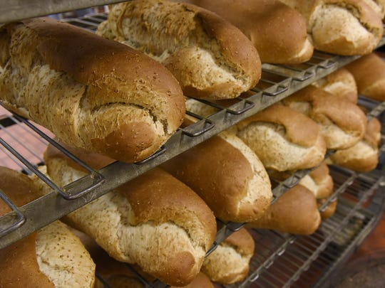 A batch of freshly baked bread cools Wednesday at St.