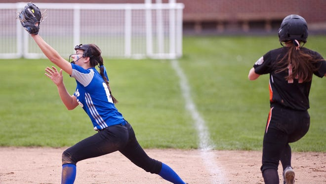 Colchester first baseman Alli Sheets, left, snares a throw to put out Middlebury's Payton Buxton during a high school softball game in Colchester earlier this season.