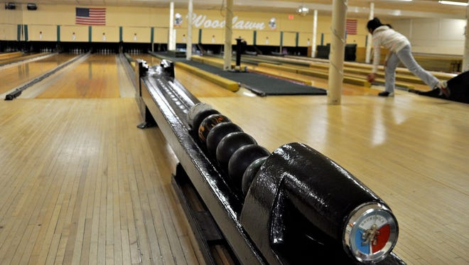 Duckpin bowling balls are just the right size for small hands.