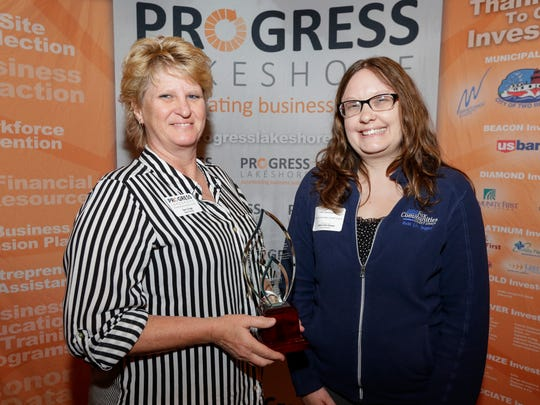 Allstates Rigging's Sam Grage, left, accepts the Economic Accelerator of the Year award from Fox Communities Credit Union's Katie Beckmann during the Progress Lakeshore Awards Breakfast at the Holiday Inn Tuesday, May. 15, 2018, in Manitowoc, Wis. Josh Clark/USA TODAY NETWORK-Wisconsin