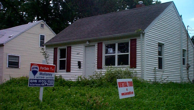 This 2008 LSJ file photo shows a Lansing home under foreclosure.