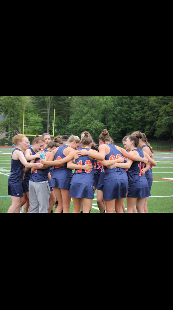 Briarcliff girls lacrosse team huddling last spring