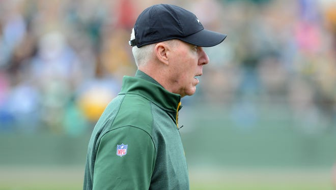 Packers general manager Ted Thompson watches training camp practice at Ray Nitschke Field.