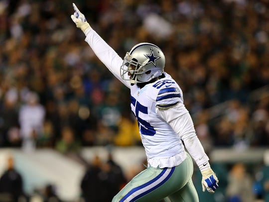 Rolando McClain celebrates a play during the Cowboys'