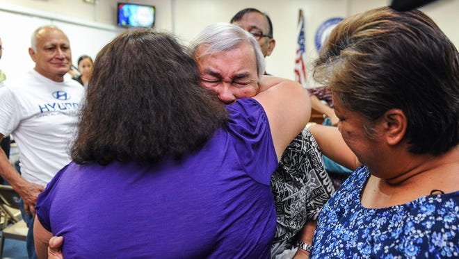 Leo Tudela, 73, is comforted by Josie Redmond after he testified in support of Bill 326 at the Guam Legislature in Hagatna on Monday, Aug. 1. Tudela testified that as a child, he served as an altar boy with the Mount Carmel Church in Chalan Kanoa, Saipan until he was given the opportunity to attend Catholic school on Guam. Tudela told lawmakers during his testimony that he was sexually abused by three Guam clergymen on three different occasions.