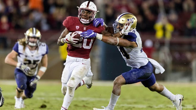 Stanford  running back Bryce Love runs the ball against Washington in the third quarter at Stanford Stadium.