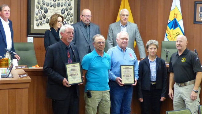 Representing the two volunteer fire departments from left, were Bonito Chief Carl Bartley, Bonito Safety Officer Rick Hall, Arabela Deputy Chief Cliff Crouch and his wife, Bess, and Joe Kenmore, county emergency services director. In back from left, are commissioners Tom Stewart, Elaine Allen, Vice Chairman Dallas Draper and Lynn Willard.